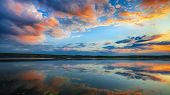 Dramatic Sunset Over The Lake.water Lilies On The Lake. Sky And Clouds Reflection On Lake poster