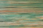 Old Shabby Wooden Fence Background. Rustic Boards With Shabby Green Paint. Aged Timber Surface. poster