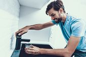 Man In Shirt Drinking Water In Kitchen At Home. Healthcare Concept. Fresh Water. Man In Shirt. Ma In poster