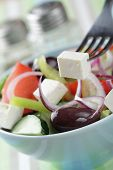 stock photo of kalamata olives  - Greek salad with kalamata olives in the bowl closeup - JPG