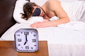 Healthy Sleep Tips. Alarm Clock Before Ringing. Man In Eye Mask Sleep Better. Guy Prefer Relax In Da poster