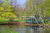 A cottage or building alongside a lake in the Halifax Public Garden, Halifax, Nova Scotia, Canada.