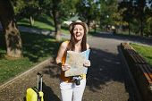 Young Laughing Traveler Tourist Woman In Yellow Summer Casual Clothes Hat With Suitcase Holding City poster