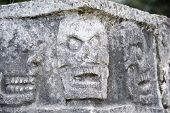 image of gruesome  - Carving Detail of Gruesome Heads Decorating the Platform of Skulls Tzompantli Chichen Itza Toltec Maya Ruins Yucatan Peninsula Mexico 2007 NR - JPG
