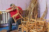 Senior Master Of Wicker-work Making Kids Chair poster