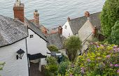 View Down To Rooftops And Sea At Clovelly In Devon, England. poster