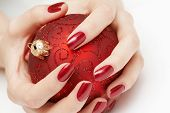 image of nail-art  - hands holding precious red Christmas globe - JPG
