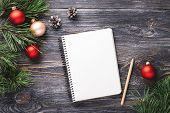 Mockup With White Paper Notebook And Christmas Decorations On Wooden Table. Top View. poster