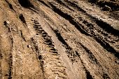 Deep Car Rut On A Dirt Road. Empty Countryside Dirt Wet Road. poster
