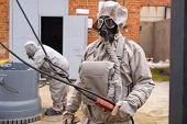 Man Works In A White Chemical Protection Suit And A Gas Mask. Chemical Hazards. poster