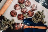 Sweets With Cannabis. Cannabis Buds On A Black Background. Baking With The Addition Of Cbd. Sweets W poster