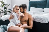 View Of Passionate Sexy Couple Cuddling In Bedroom poster