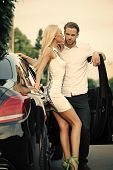 Sensual Woman And Man At Auto Outdoor. Sexy Couple At Car On Summer Day. Business Trip, Travel, Busi poster