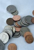 stock photo of splayed  - It is a bunch of coins splayed about in a semi - JPG