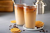 Iced Coffee In Tall Glasses Made With Coffe Ice Cubes Served With Cookies poster