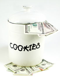 foto of skinny fat  - white cookie jar isolated on white with focus on the letters cookies filled with money and on top of money as well - JPG