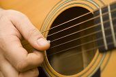 picture of acoustic guitar  - close up of hands playing an acoustic guitar - JPG