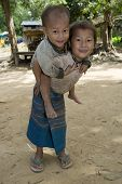 picture of hmong  - Hmong girl with brother Laos children in Asia - JPG