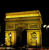 stock photo of gaul  - The Arc De Triomphe floodlit at night - JPG