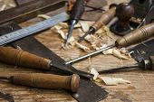 stock photo of woodcarving  - joiner tools chisel and meter on wood table background - JPG