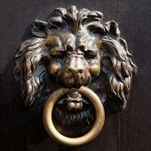 Antique lion's head doorknocker in Aachen, Germany