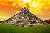 stock photo of mayan  - Amazing sky over Kukulkan pyramid in Chichen Itza - JPG