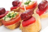 image of piquillo pepper  - closeup of a plate with different spanish pinchos - JPG