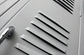 picture of louvers  - white school lockers with close up of louvers - JPG