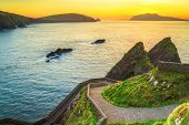 stock photo of ireland  - Sunset over Dunquin bay on Dingle Peninsula - JPG