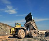 pic of iron ore  - unloading truck in a career of iron ore - JPG