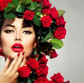 stock photo of rose  - Beauty Fashion Model Girl Portrait with Red Roses Hairstyle - JPG
