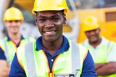 image of heavy equipment operator  - happy african american construction worker in front of colleagues - JPG