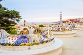stock photo of gaudi barcelona  - View of colorful ceramic mosaic bench of park Guell designed by Antonio Gaudi in Barcelona Spain - JPG