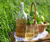 foto of cider apples  - Apple drink and basket with green apples outdoors - JPG