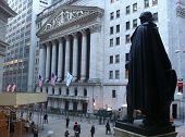 NEW YORK - MAY 13: From Federal Hall, pedestrians walk along Broad Street past the New York Stock Ex