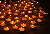 stock photo of memorial  - Burning candles on dark background - JPG