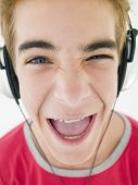 Teenage Boy Wearing Headphones And Smiling