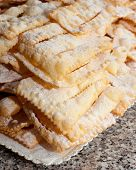 pic of frappe  - Chiacchiere or frappe italian cake on table - JPG