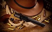 picture of gunslinger  - Western accessories on wooden table  - JPG