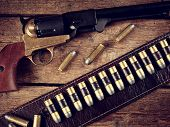 stock photo of gunslinger  - Western accessories on wooden table  - JPG