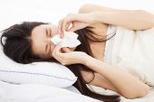 stock photo of laying-in-bed  - young Woman with flu and laying in bed - JPG