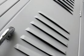 stock photo of louvers  - white school lockers with close up of louvers - JPG