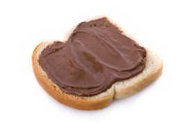 pic of fresh slice bread  - Hazelnut and chocolate spread over a slice of bread - JPG