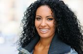 pic of braces  - Portrait of a young black woman smiling with braces - JPG