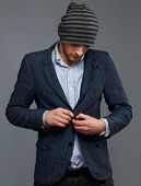 picture of beanie hat  - Stylish young man in jacket and beanie hat - JPG