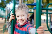 stock photo of father time  - cheerful positive kid spending fun time at the playground - JPG