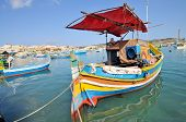 foto of maltese  - Traditional Maltese fishing boats called Luzzu in the harbour of Marsaxlokk Malta - JPG