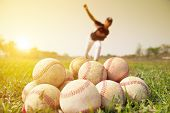 image of  practices  - Baseball players practicing pitching outside. baseball concept.