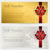 stock photo of bowing  - Gold and silver gift voucher with red bow  - JPG