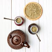 image of calabash  - Yerba mate and calabashes on a light wooden background top view - JPG